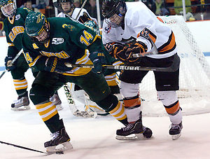 Kevin Lohry (Princeton - 12) tries to take the puck away from Jake Morley (Clarkson - 14). (Shelley M. Szwast)