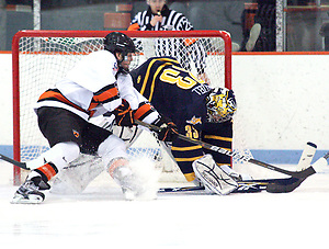 Eric Hartzell (Quinnipiac - 33) makes a save on Rob Kleebaum (Princeton - 39).  Hartzell stopped 34 of 35 shots to help Quinnipiac earn a 1-1 tie with Princeton at Hobey Baker Rink, in Princeton, NJ. (Shelley M. Szwast)
