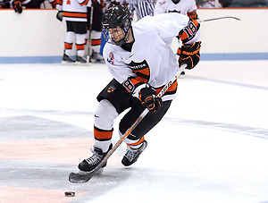 Andre Calof (Princeton - 18) carries the puck through the neutral zone against Quinnipiac at Hobey Baker Rink, in Princeton, NJ. (Shelley M. Szwast)