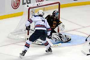 2010 IIHF World U20 Championship - #3 Charlie Coyle scored the first USA goal over the right shoulder of #1 Philipp Grubauer. Note the puck at the post; Copyright 2010 Angelo Lisuzzo (Angelo Lisuzzo)