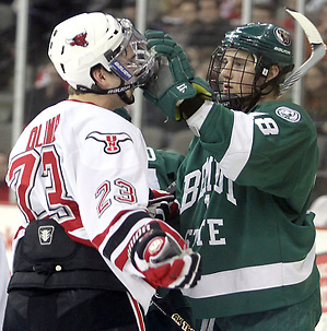 Bemidji State's Radoslav Illo adjusts the facemask of UNO's Eric Olimb during the first period. Illo received a penalty on the play. UNO and Bemidji State skated to a 2-2 tie Friday night at Qwest Center Omaha. (Photo by Michelle Bishop) (Michelle Bishop)