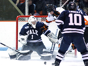 Alec Rush (Princeton - 2) jumps as Rob Kleebaum (Princeton - 39) scores his second goal of the game on goaltender Ryan Rondeau (Yale - 1). Princeton University hosted the Yale Bulldogs at Hobey Baker Rink in Princeton, NJ. After falling to an early 3-0 deficit, the Yale Bulldogs rallied to defeat Princeton 5-4. (Shelley M. Szwast)