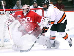 Jack Berger (Princeton - 9) collides with goaltender Mike Garman (Cornell - 35) as Garman shifts to make a save on a shot from the point. (Shelley M. Szwast)