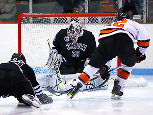 Goaltender Keith Kinkaid (Union - 30) makes a save on Kevin Lohry (Princeton - 12). Kinkaid made 28 saves as the Union College Dutchman visited Hobey Baker Rink in Princeton, NJ, defeating Princeton 7-4. (Shelley M. Szwast)