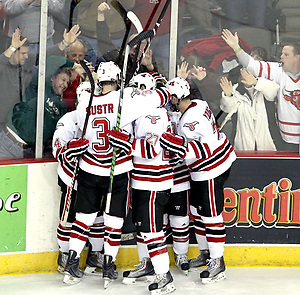 UNO celebrates Rich Purslow's empty-net goal during the third period. Nebraska-Omaha beat Denver 5-2 Friday night at Qwest Center Omaha.  (Photo by Michelle Bishop) (Michelle Bishop)