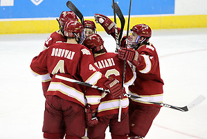 Denver celebrates Drew Shore's goal during the first period. Denver beat Nebraska-Omaha 4-2 Saturday night at Qwest Center Omaha. (Photo by Michelle Bishop) (Michelle Bishop)