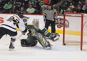 Colorado College's William Rapuzzi scores past Alaska-Anchorage's Chris Kamal in the first period of their WCHA Final Five quarterfinal game Thursday, March 17, 2011. (Tim Brule)