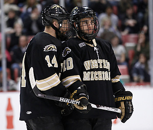 Western Michigan captain Ian Slater (14) chats with teammate J.J. Crew during a timeout in the second period of the CCHA Championship game at Joe Louis Arena in Detroit, Michigan on March 19, 2011. (Rena Laverty)
