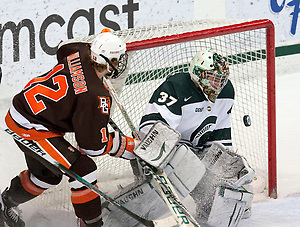Michigan State freshman goaltender Will Yanakeff prepares to stop the puck as Bowling Green forward Bryce Williamson follows it with his eyes. Yanakeff only allowed one goal in against the Falcons, leading Michigan State to a 2-1 defeat. (Erica Treais)