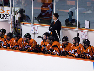 Coach Guy Gadowsky and the Princeton bench watch the action during the first period of their game against Dartmouth. (Shelley M. Szwast)