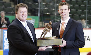 Chuck Long presents the 2011 Hockey Humanitarian Award to Brooks Dyroff of Boston College.. (Jim Rosvold)