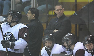 Union associate head coach Rick Bennett (back, standing) watches over the bench. (Union Athletics)