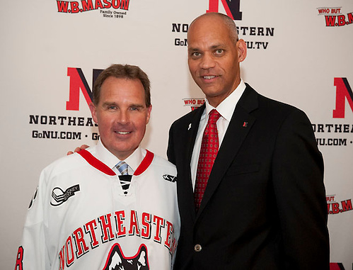 New Northeastern coach Jim Madigan poses with athletic director Peter Roby. (Mike Mazzanti - Northeastern University)