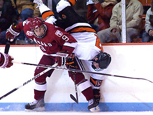 Brodie Zuk (Princeton - 19) gets flipped by Danny Biega as he was checked along the boards. (Shelley M. Szwast)