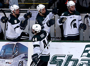 Captain Torey Krug celebrates his hat trick with the Spartan's. The Spartan's beat Michigan in overtime, 4-3. (Erica Treais)
