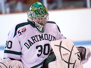 Dartmouth goaltender James Mello makes a save during the first period of their victory over Princeton. Mello faced 35 shots in the game, but held the Tigers to just two goals. (Shelley M. Szwast)