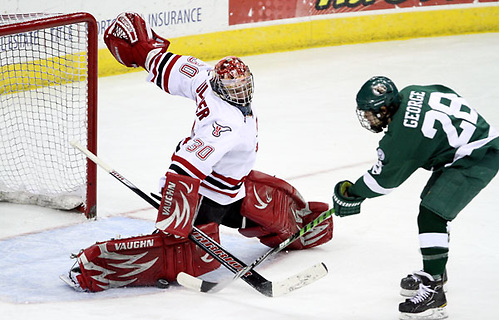 Nebraska-Omaha goalie John Faulkner stops Bemidji State's Jordan George during a breakaway in the second period. Bemidji State beat UNO 3-2 Saturday night at Qwest Center Omaha to win the best-of-three WCHA first-round series. (Photo by Michelle Bishop) (Michelle Bishop)