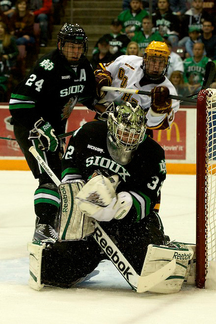 6 Nov 11: Ben Blood (North Dakota 24), Aaron Dell (North Dakota - 32), Erik Haula (Minnesota - 19) The University of Minnesota Golden Gophers host the University of North Dakota Fighting Sioux in a WCHA matchup at Mariucci Arena in Minneapolis, MN. (Jim Rosvold)