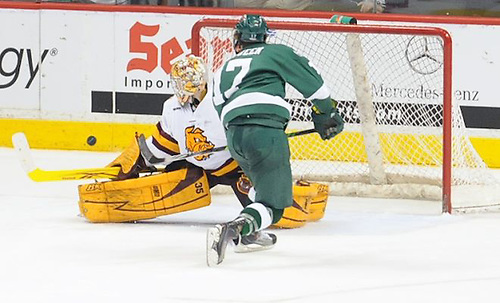 Minnesota-Duluth's Kenny Reiter stops Bemidji State's Jamie MacQueen on a penalty shot. (Tim Brule)