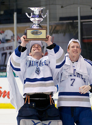 AHA tournament MVP Jason Torf and teammate Casey Kleisinger of Air Force celebrate their AHA championship victory over RIT (2012 Omar Phillips)