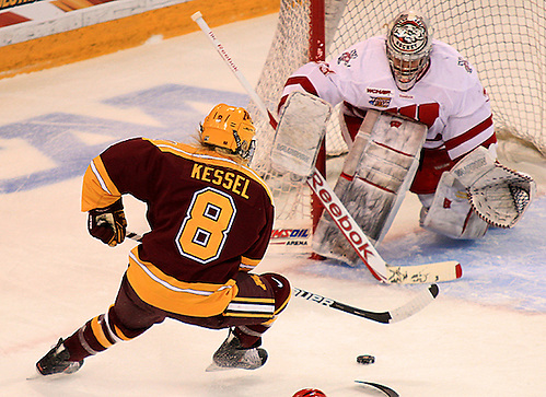 Minnesota's Amanda Kessel makes a move on Wisconsin goaltender Alex Rigsby.  Kessel scored 5-hole on Rigsby to give the Gophers a 1-0 lead. (2012 Dave Harwig)