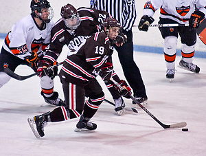 Matt Lorito (Brown - 19) plays the puck as Rob Kleebaum (Princeton - 39) and Chris Zaires (Brown - 22) battle. Princeton and Brown tied 2-2 at Hobey Baker Rink in Princeton, N.J. (Shelley M. Szwast)