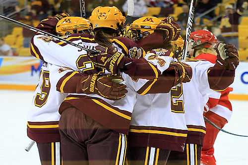 Gopher players celebrate an Amanda Kessel first period goal vs Cornell in the NCAA Semifinal at Amsoil Arena in Duluth, MN (2012 Dave Harwig)