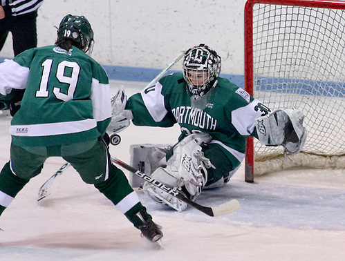 Lindsay Holdcroft ((Dartmouth - 30) makes a save as Reagan Fischer ((Dartmouth - 19) skates in to play the rebound. Princeton and Dartmouth tied 2-2 at Hobey Baker Rink in Princeton, N.J. (Shelley M. Szwast)