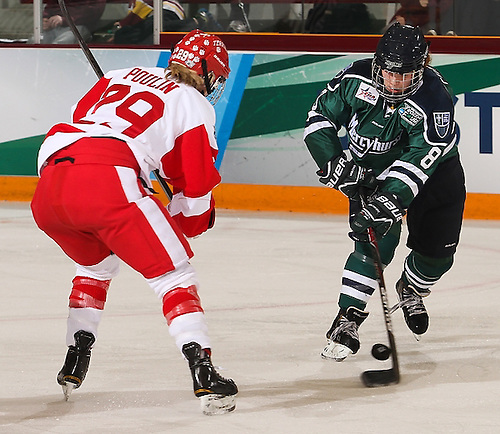 Kaleigh Chippy of Mercyhurst advances on Boston University's Marie-Philip Poulin. (Ryan Coleman/Ryan Coleman, USCHO.com)