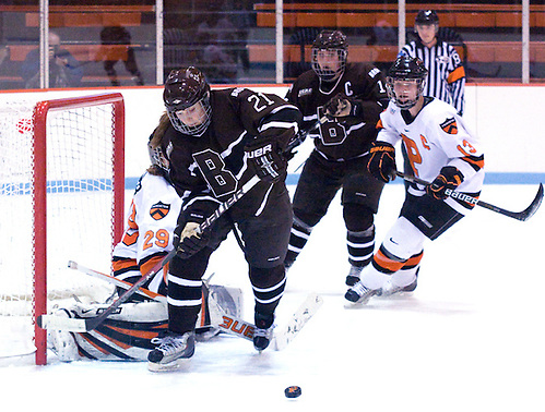 Jessica Hoyle (Brown - 21) goes after a rebound in front of goaltender Rachel Webber (Princeton - 29), as Laura Martindale (Princeton - 13) battles for position with Jenna Dancewicz (Brown - 14). (Shelley M. Szwast)
