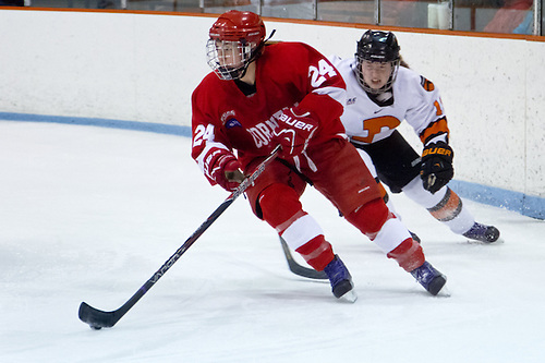 Hayleigh Cudmore (Cornell -24) plays the puck away from Cristin Shanahan (Princeton -19). (Shelley M. Szwast)