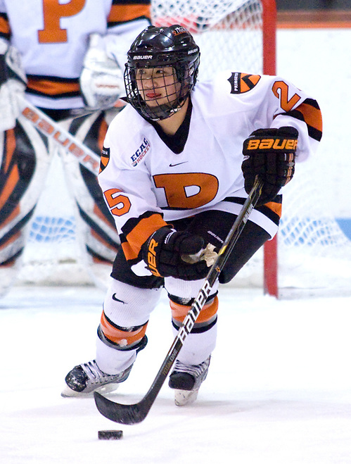 Rose Alleva (Princeton - 25) carries the puck out of the defensive zone.  Alleva assisted on Romanchuk's second goal of the game as the Tigers defeated Syracuse 5-0. (Shelley M. Szwast)