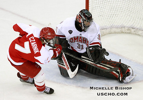 Nebraska-Omaha goalie Ryan Massa stops Miami's Austin Czarnik on a penalty shot. Nebraska-Omaha beat No. 8 Miami 6-3 at the CenturyLink Center in Omaha on Friday. (Photo by Michelle Bishop) (Michelle Bishop)