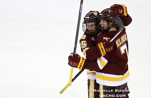 Minnesota Duluth's Andy Welinski (7) celebrates his third period goal with Justin Crandall. Minnesota Duluth beat Nebraska-Omaha 3-2 at the CenturyLink Center in Omaha on Friday. (Photo by Michelle Bishop) (Michelle Bishop)
