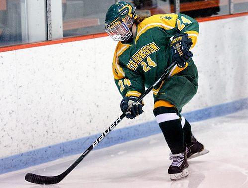 Brittany Styner (Clarkson - 24) plays the puck behind the net. Clarkson defeated Princeton 2-1 at Hobey Baker Rink in Princeton, N.J. (Shelley M. Szwast)