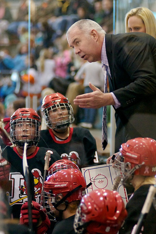 Coach Kevin Houle of Plattsburgh talks with his team (2012 Omar Phillips)