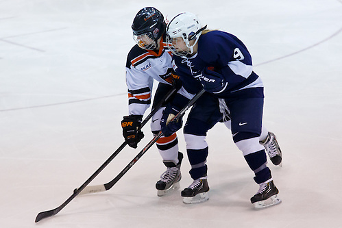 Denna Laing (Princeton - 14) and Amy Petersen (Penn State - 9) battle for position at center ice. (Shelley M. Szwast)