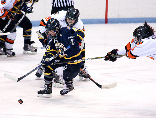 Erica Uden Johansson (Quinnipiac - 13) plays the puck out of the reach of Charrissa Stadnyk (Princeton - 11) and Paula Romanchuk (Princeton - 18), Quinnipiac defeated Princeton 2-0 at Hobey Baker Rink in Princeton, NJ. (Shelley M. Szwast)