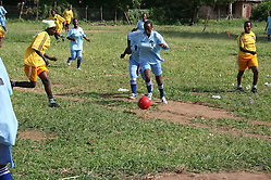Play in the first game of the Nikumbuke Women's Soccer League. (Tim Brule)