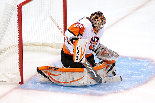 Ali Binnington (39 - RIT) makes one of her 19 saves in a 2-1 win against Union (Omar Phillips)