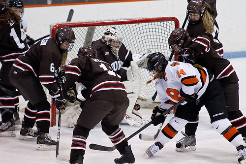 Denna Laing (Princeton -14) takes a shot on Aubree Moore (Brown - 35) as Kelly Micholson (Brown - 6), Vanessa Welten (Brown - 11), and Victoria Smith (Brown - 7) defend the rebound. (Shelley M. Szwast)