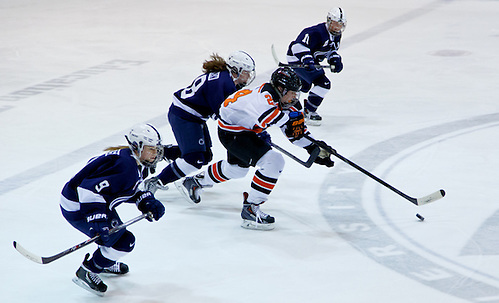 Fiona McKenna (Princeton - 24) plays the puck as Amy Petersen (Penn State - 9), Laura Bowman (Penn State - 18), and Micayla Catanzariti (Penn State - 10) give chase. (Shelley M. Szwast)