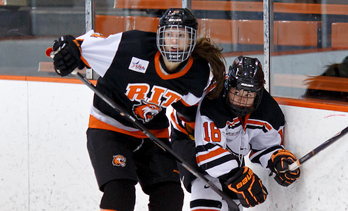 Mackenzie Stone (RIT- 14) and Hilary Lloyd (Princeton - 18) battle along the boards. ((c) Shelley M. Szwast 2013)