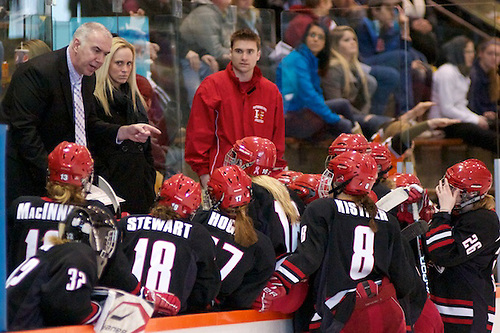 Plattsburgh coach Kevin Houle talks to his players during a stoppage of play (2012 Omar Phillips)