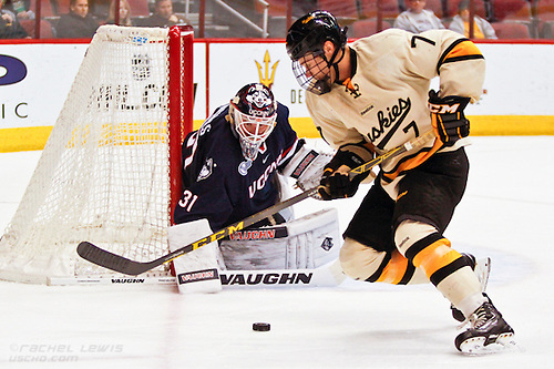 2016Jan08:  Rob Nichols (UConn - 31), Reid Sturos (Mich Tech - 7)  Game 1 of the Desert Hockey Classic has two Husky teams facing off against one another, UConn and Michigan Tech. (©Rachel Lewis)