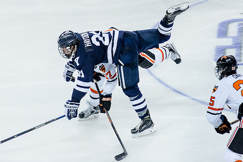 John Hayden (Yale - 21) and Garrett Skrbich (Princeton - 17) battle in the neutral zone. (Shelley M. Szwast)