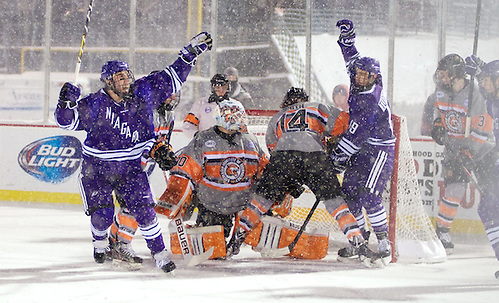 TJ Sarcona (21, left), Hugo Turcotte (19) - RIT and Niagara skated to a 2-2 tie at the Frozen Frontier, an outdoor hockey event in Rochester, NY. (Omar Phillips)