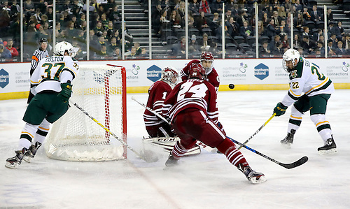 Press Eye - Belfast -  Northern Ireland - 25th November 2016 - Photo by William Cherry Vermont Catamounts' Ross Colton and Brady Shaw with UMass Minutemen's Ryan Wischow and Shane Bear during Friday afternoons Friendship Four game at the SSE Arena, Belfast.  Four teams from the USA are competing in the NCAA mens ice-hockey tournament in the hope of winning the Belpot Trophy. Photo William Cherry/Presseye (©William Cherry / Presseye)