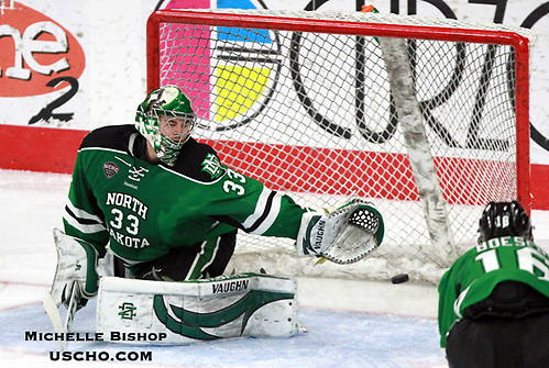 North Dakota goalie Cam Johnson is unable to stop a shot by Omaha's David Pope during the third period. North Dakota beat Omaha 7-3 Saturday night at Baxter Arena. (Photo by Michelle Bishop) (Michelle Bishop)