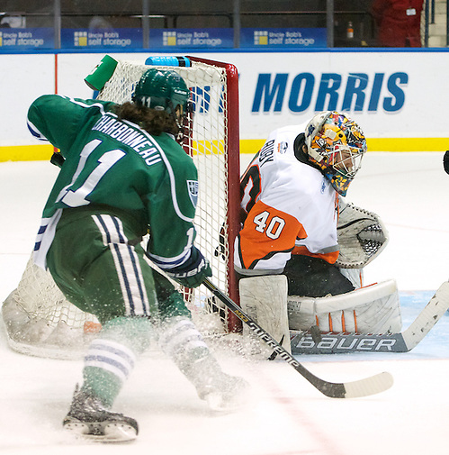 Jordan Ruby (40 - RIT) makes a save on a shot by Jonathan Charbonneau (11 - Mercyhurst) (Omar Phillips)